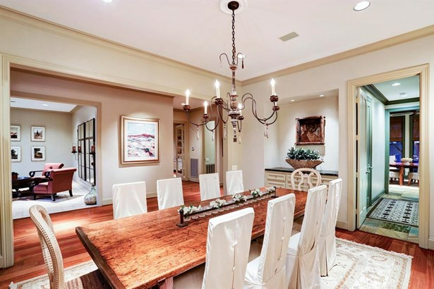 This big formal dining room is perfect for dinners with family and friends. It is also located right off of the kitchen. (photo 4)