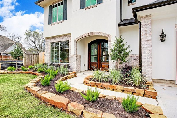 Home will feature evergreen landscaping complimenting the traditional stucco and brick facade. Example of builder's previous work. Construction has not yet started. (photo 2)