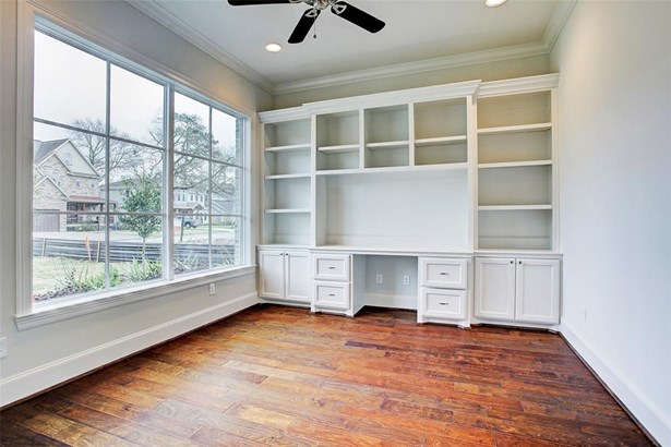 1502 Pine Chase will offer a study to the right of the foyer with built in shelving/knee space. Hardwood floors run seamlessly throughout the first floor. Example of builder's previous work. Construction has not yet started. (photo 4)