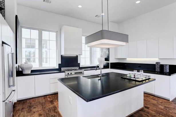 Cooking and entertaining is a dream in this fabulous kitchen. Cabinets by Poliform, imported from Italy. This incredible work space is equipped with Bertazzoni gas range & microwave, Blomberg dishwasher & the refrigerator is included! (photo 2)