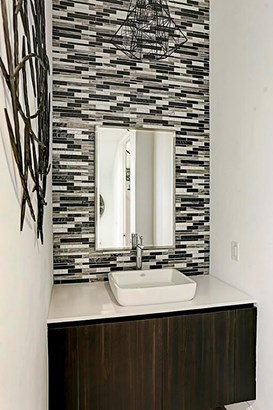 This mosaic tile wall is a beautiful upgrade option found in the powder room of one of our other model homes. (photo 5)