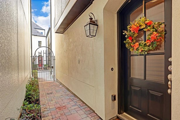 The gated entryway leading to the front door. (photo 2)