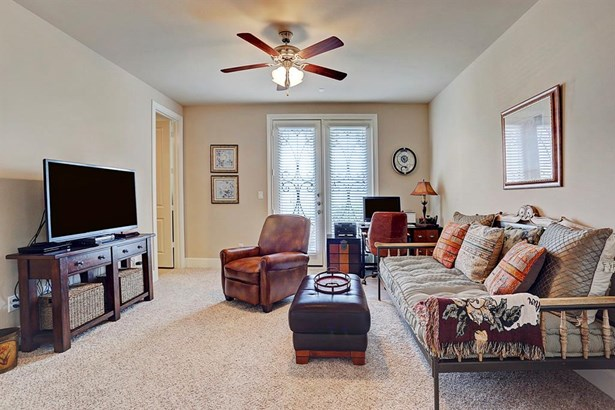 The 13x14 2nd bedroom/1st floor suite has carpet, ceiling fan with light kit, and French doors to leading to back yard/patio. (photo 4)