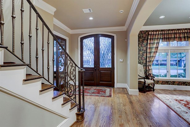 Beautiful double arched French doors with cut glass open to a spacious foyer that flow perfectly into the other parts of the house. This home is perfect for entertaining or everyday living! (photo 2)