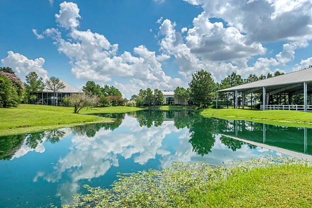 TWO LAKES meander around the property with opportunities for riding your ponies in the COVERED ARENA, taking a KAYAK to paddle around, or challenge someone to a friendly game of TENNIS or BAKSETBALL in the COVERED SPORT COURT. (photo 4)