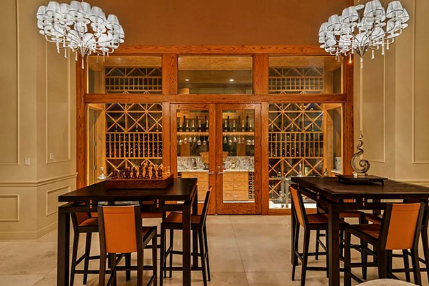 Showcase your collection of fine wines and spirits in the glass enclosed temperature controlled WINE ROOM in the GRAND SALON. Tip your crystal glass while enjoying a game of chess or just friendly conversation. (photo 5)