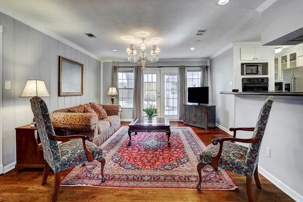 Formal living room with French doors overlooking the large back yard (photo 1)