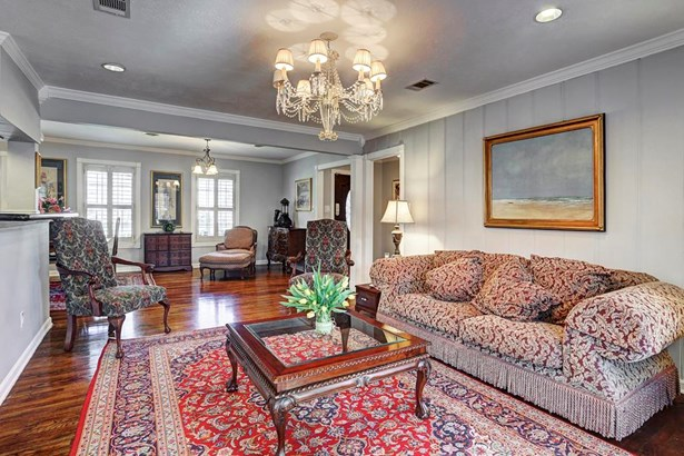 Another view of the formal living room with wood floors throughout the house (photo 5)