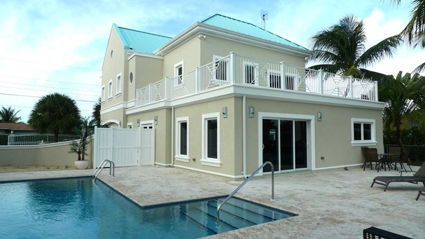 Governors Harbour Executive Canal Front Home for rent, Seven Mile Beach Property (photo 1)
