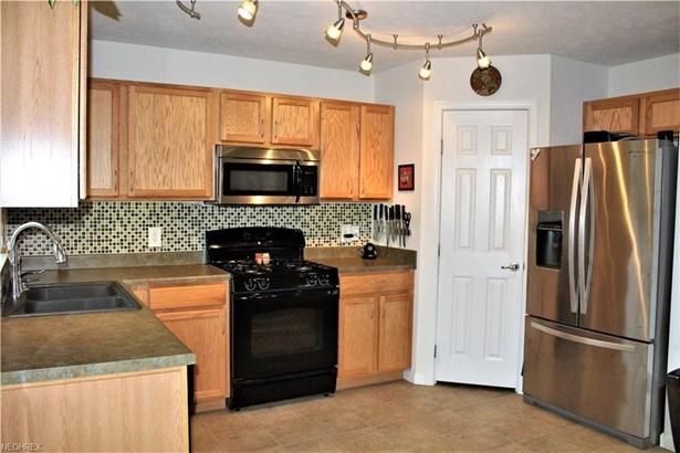 Oak Cabinets & Pantry (photo 4)
