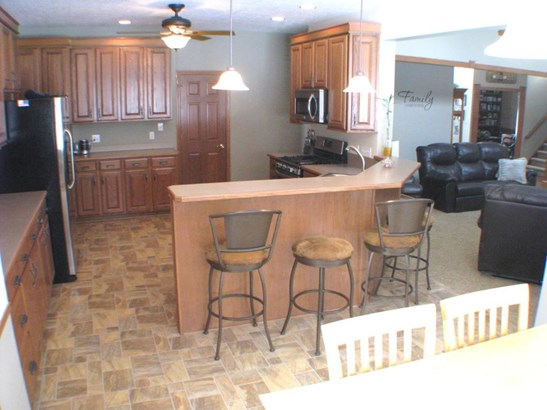 Spacious, opens to family room, bright eat in area with awesome views of the acreage (photo 5)