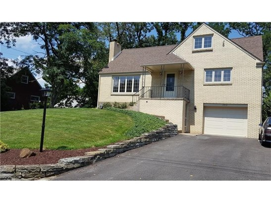 Features four bedrooms, two full baths, finished family room, one car garage. (photo 2)