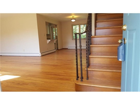 Front entry welcomes you with the nicely refinished hardwood floors and wood stairway to the second floor. (photo 3)