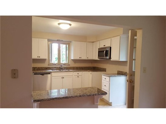 Totally updated kitchen with Granite Counter Tops, sink, fixtures, and access to the back deck. (photo 5)