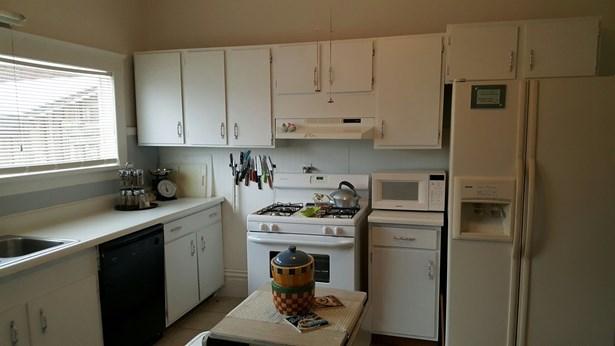 Freshly painted with plenty of storage, newer gas range, dishwasher and fridge included!! (photo 2)