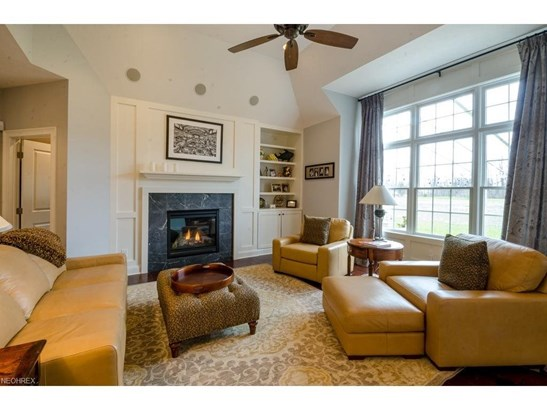Vaulted with a Ceiling Fan, Surround Sound Speakers, Hardwood Floor, Built In Shelving and Storage, Gas Fireplace and Large Bay Window with Transom. (photo 4)