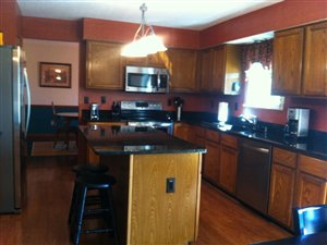 You will love this updated kitchen new appliances, granite counter top and engineered hardwood floors!  Tons of features! (photo 2)