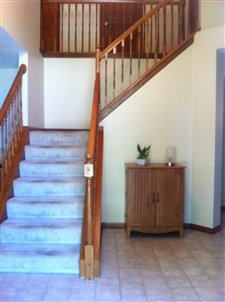 Newer ceramic tile leading into the two story foyer.  Beautiful 6 panel doors and lots of woodwork (photo 3)
