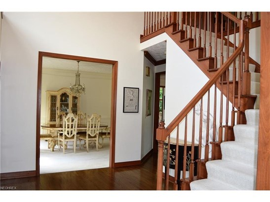 Wood floors and an open staircase in this two-story foyer will welcome your guests... (photo 2)