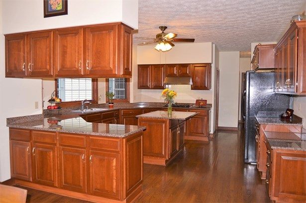 This beautiful kitchen with rich cherry cabinetry is truly the heart of this home... (photo 4)