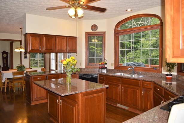 Granite countertops, double ovens and an island with seating... (photo 5)