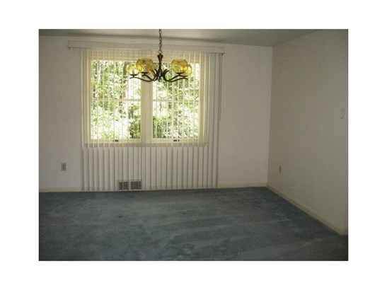 Spacious Dining room with double windows and light fixture. (photo 4)