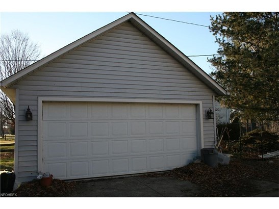 This home offers a 2-car attached, AND a 2-car detached garage. (photo 2)