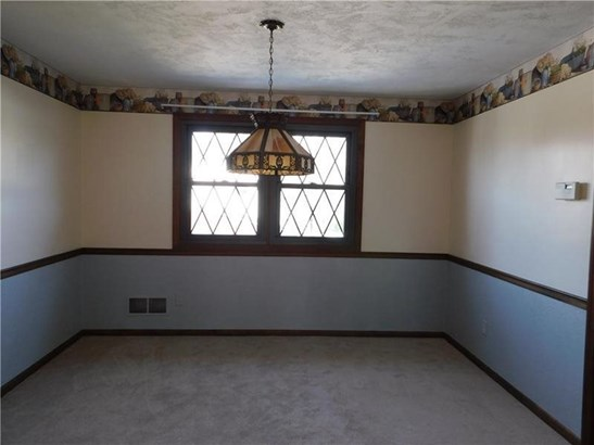 Spacious Dining Room with double windows, chair rail, and neutral carpet. (photo 3)