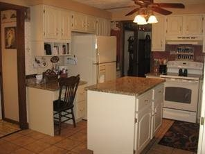 New Granite counter tops, built in desk, and flooring. (photo 5)