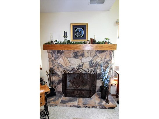 Stone-Faced Gas Logged Fireplace Located in Great Room (photo 3)