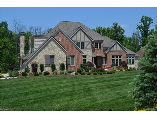 Beautifully manicured landscape surrounds this stately brick and stone colonial in Windsor Park (photo 1)