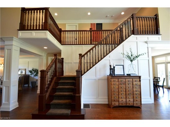 magnificent two-story open staircase and landing above (photo 5)