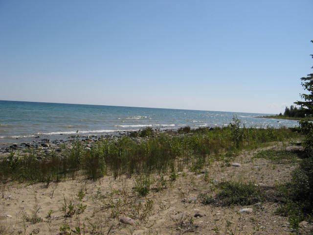 Sandy, Rocky Shoreline (photo 3)