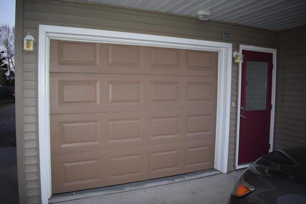 Attached garage (photo 3)