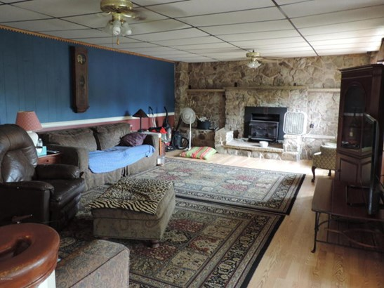 Living Room with Stone Wall and Fireplace (photo 2)