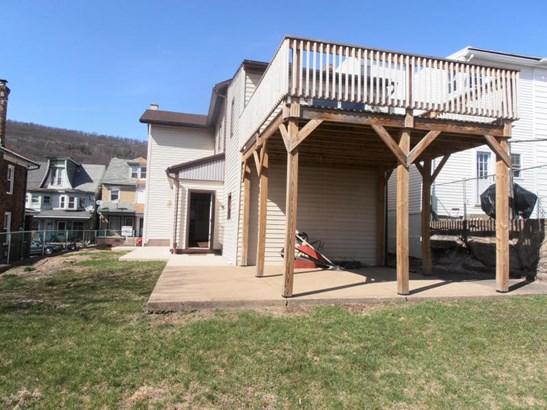 Large deck off 2nd floor, patio below (photo 2)