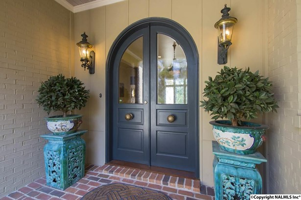 Refined doors offer a preview of the fine craftsmanship found throughout this house from beginning to end! (photo 1)