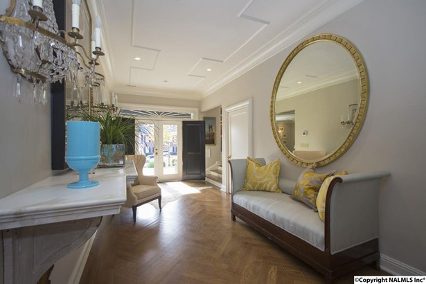 This extra wide foyer makes a grand statement when you enter this lovely home. The hardwood floors laid in a herringbone pattern accentuate this grand entrance with style. (photo 5)