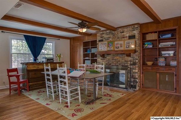 This is the other view of the family room with large masonary fireplace and built-ins throughout this room and it is open to the kitchen area for easy flow. (photo 5)