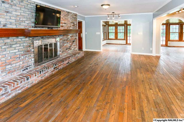 Hardwood floors and brick gas log FP is cozy and spacious. (photo 3)