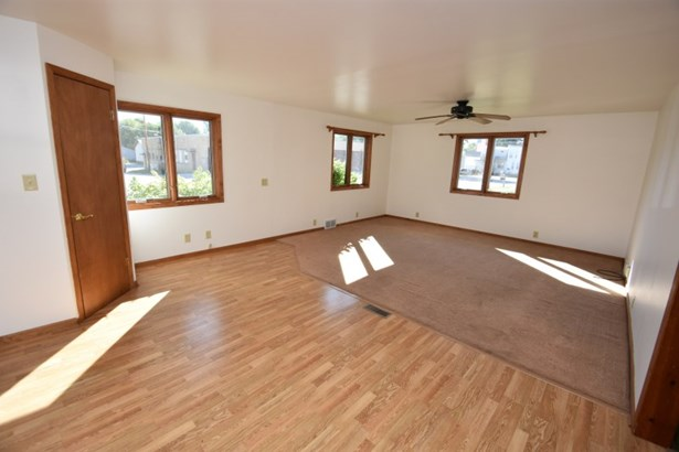 Living Room w/ laminate entry (photo 2)