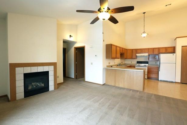 Living Area Flows into Kitchen (photo 3)