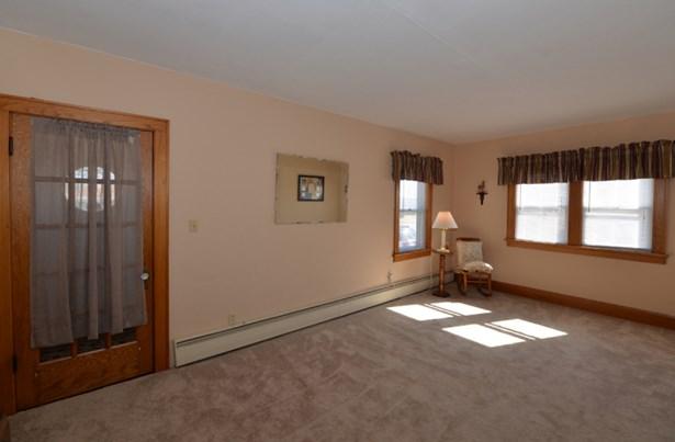 Living room to front door (photo 5)