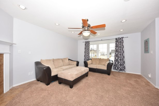 Living Room with gas fireplace (photo 4)