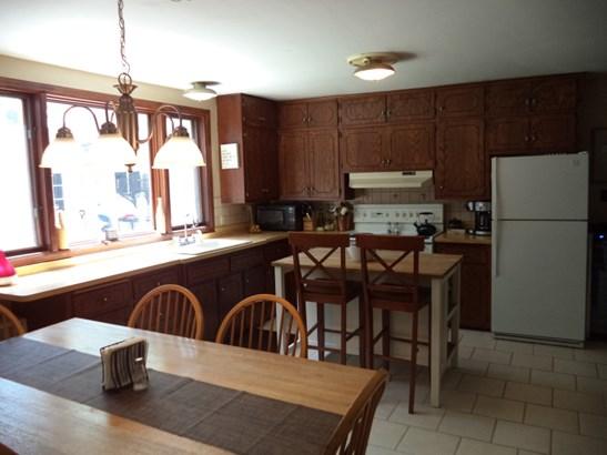 Unit #1 kitchen-tiled floor (photo 2)