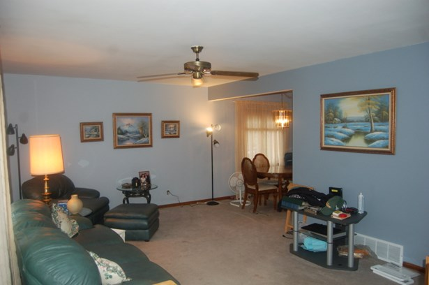 living room opens to dining L (photo 3)
