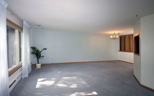 Living room w/ view of Dining (photo 2)