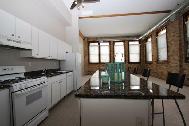 Living Room w/ Large Windows (photo 2)