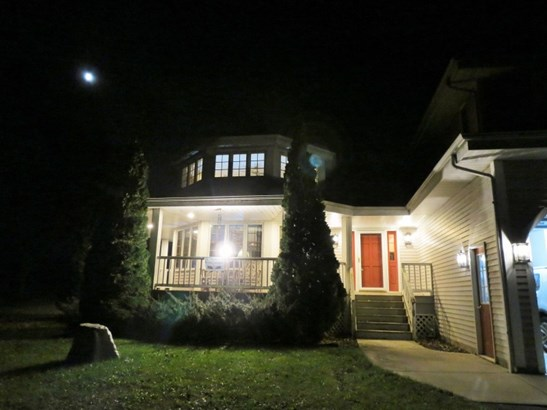 NIGHT VIEW OF FRONT PORCH (photo 2)