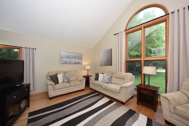 Sunburst window in living room (photo 5)